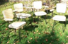 Suite de 4 fauteuils en skaï moiré jaune piètement eiffel années 60