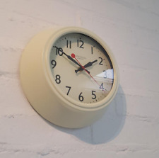 An impressive looking retro all clock with a cream metal