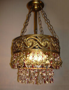 Antique gilded cascading crystal Chandelier with red raspberry accents, 1920's