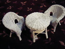 small table and chairs in white wicker