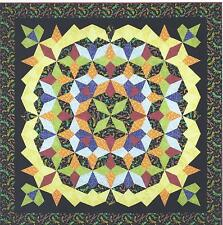 Dragonfly Dance kaleidoscope puzzle quilt by Maggie Ball for Quilt Woman