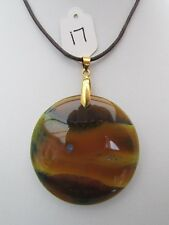 A YELLOW/BLUE AGATE PENDANT ON A WAXED CORD NECKLACE.  44mm x 44mm  (17)