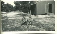 military photo bare chest soldiers posing squatting in front of barracks gay