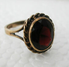A FINE VINTAGE 9K  GOLD RING SET WITH AN OVAL FACETED 2 CARATS GARNET-SIZE 5 1/8