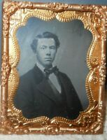 1/9th size Tintype of a young man in a Brass frame