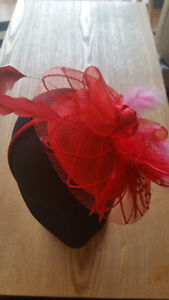 Fascinator- Red sinamay with red and pink feathers on sinamay base & headband
