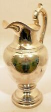 A tall coin silver water pitcher, with bird crest, Ball, Tompkins & Black, NY c.