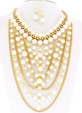 Gold Toned Herringbone Necklace With Cream Colored Pearls and Matching Earrings