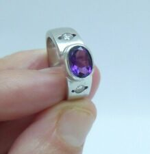 A Smart and Fine Quality 18ct White Gold Amethyst and Diamond Ring.