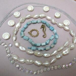 Shiva Eye Shell+ Larimar chunks + Pearls +Rainbow Crystal +Seahorse clasp+seed