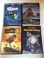 4 Disney Dvds Finding Nemo, Dinosaur, Lion Kong 1 1/2, Rocketman
