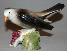 VINTAGE HAND MADE PORCELAIN BIRD FIGURINE