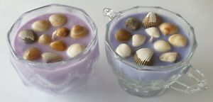 2 SOY CANDLES. HOME MADE BEAUTIFUL SCENT AND COLOR IN DECORATIVE GLASS BOWLS.