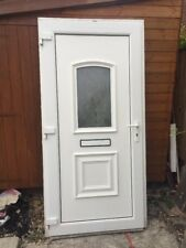 White upvc Front, Back, Garage Door.