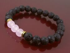 BLACK LAVA STONE HEALING BRACELET WITH PINK SEMI PRECIOUS STONE BEAD DETAILS.