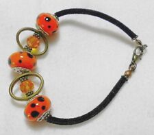 "7.25"" Bracelet, orange 14mm glass beads, black velvet cord, dots"