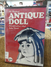 The Standard ANTIQUE DOLL IDENTIFICATION AND VALUE GUIDE