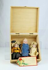 Three Antique German All Bisque Dolls in Wooden Christmas Box and Tag