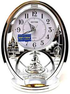 Rhythm Contemporary Mantel Clock Oval Silver with Arabic Dial and Rotating Pendu