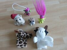 Six collectable little toys, two of which are finger puppets.