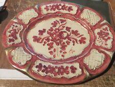 Grand plateau en céramique rouge,  blanc et or – N° 157/B – signé « Riga » - tra