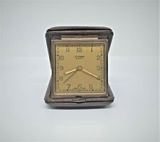 Vintage Swiss Cyma Amic travel alarm clock.