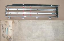 NOS 1980 PONTIAC GRAND LEMANS LH TAILAMP-BACKUP LAMP BEZEL 5930457  NEW GM PART