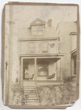 ANTIQUE PHOTOGRAPH OF OLD HOME, YOUNG GIRL ON THE PORCH HOLDING YOUNGER CHILD.