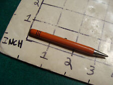 vintage tiny, super cool looking unmarked pencil, mechanical Orange/red color