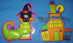 TWO ASSORTED PLASTIC HALLOWEEN THEMED CAKE TOPPERS