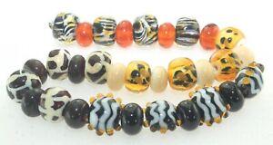 OliveStuart Handmade Lampwork Beads 31 amber/cream/black round/lentil