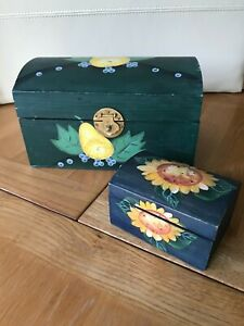 Two green decorative wooden boxes