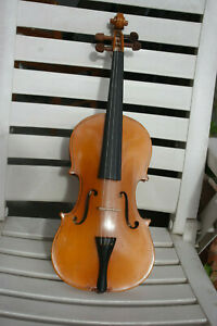 Violin in Hard case with Bow , Chin rest, bridge and new strings. 1/2 size.