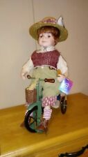 Ashley Belle porcelain doll boy on bike