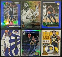 Lot of (6) Tyreke Evans, Including Prizm blue /199, Optic holo & more parallels