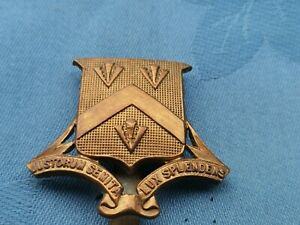 The Bloxham School Officer Training Corp cap badge.
