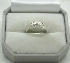 A Very Nice 9ct White Gold And Diamond Shaped Half Eternity Style Ring