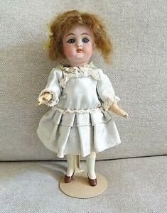 N°76/ Petite poupée ancienne, mignonette Numéro 478? 2, tête porcelaine, 14 cm.