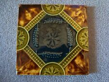 Antique majolica ceramic tile with wheat sheaf pattern in centre  21/39