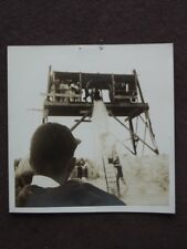 BUCKET OF WATER BEING POURED DOWN ON MEN TRYING TO CLIMB UP Vtg 1940's PHOTO