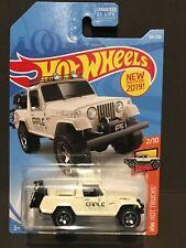Hot Wheels 1:64   Jeepster Commando Earle Motors  White  FREE SHIPPING