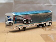 dcp chrome/teal spread axle simulated chip trailer new no box 1/64