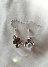 """Handmade pearl in a shell pair of earrings (""""antique silver"""").  Oyster."""