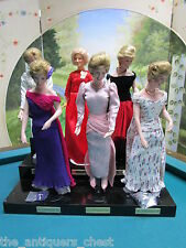 Princess Diana fashion Collection of 6 dolls in wooden stand