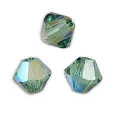 20 Perles Toupies 4mm en cristal Swarovski - ERINITE AB