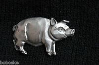 Insigne en étain représentant un cochon