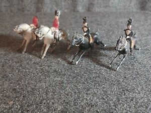 TOY SOLDIER ON HORSE  CHERILEA  BRAND SET OF FOUR METAL