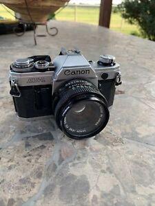 Canon AE-1 35mm Camera w/ Canon FD 50mm 1 : 1.8