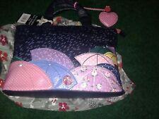 Bolsa de imágenes Yoshi lloviendo paraguas