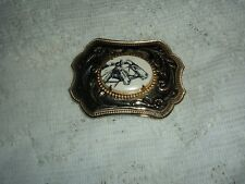 "GOLD HORSES INKED OVAL  WESTERN BELT BUCKLE 3 1/2"" X 2 1/2"" USED"